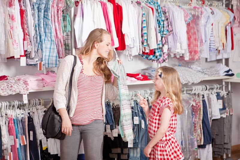 mother and daughter in a clothing store